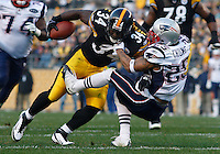 PITTSBURGH, PA - OCTOBER 30:  Rashard Mendenhall #34 of the Pittsburgh Steelers runs through a tackle by Patrick Chung #25 of the New England Patriots during the game on October 30, 2011 at Heinz Field in Pittsburgh, Pennsylvania.  (Photo by Jared Wickerham/Getty Images)