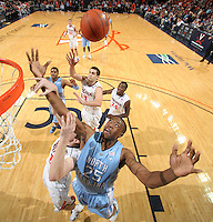 Jan. 8, 2011; Charlottesville, VA, USA;  North Carolina Tar Heels forward Justin Knox (25) fights for the rebound with Virginia Cavaliers guard Joe Harris (12) during the game at the John Paul Jones Arena. North Carolina won 62-56. Mandatory Credit: Andrew Shurtleff