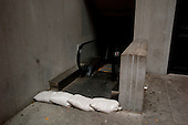 New York, New York.October 30, 2012..Sandbags cordon off the entrance to a subways station near the New York Stock Exchange after a two-day shutdown, the first to be caused by weather since a blizzard in 1888.