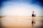 People on the beach, Sanlucar de Barrameda, Spain. Daylight long exposure shot by the use of neutral density filters.