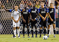 LA Galaxy forward Landon Donovan (10) positions himself in a San Jose Earthquake wall consisting of (from l to r) Cornell Glen (13), Brandon McDonald (14), Ike Opara (6), Bobby Burling (2) and Ramiro Corrales (12). The LA Galaxy and the San Jose Earthquakes played to a 2-2 draw at Home Depot Center stadium in Carson, California on Thursday July 22, 2010.