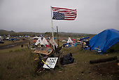 Cannon Ball, North Dakota<br /> September 23, 2016<br /> <br /> The Standing Rock Sioux encampment near the construction of the Dakota Access Pipeline stands against the construction of the new pipeline. <br /> <br /> The Standing Rock Sioux, whose tribal lands are a half-mile south of the proposed route, say the pipeline would desecrate sacred burial and prayer sites, and could leak oil into the Missouri and Cannon Ball rivers, on which the tribe relies for water.<br /> <br /> Opposition to the pipeline has drawn support from 200 Native American tribes, as well as from activists and celebrities. <br /> <br /> Energy Transfer Partners&mdash;one of the major stakeholders in the controversial Dakota Access pipeline&mdash;bought over 6,000 acres of land surrounding the line&rsquo;s route in North Dakota, according to several media reports over the weekend.