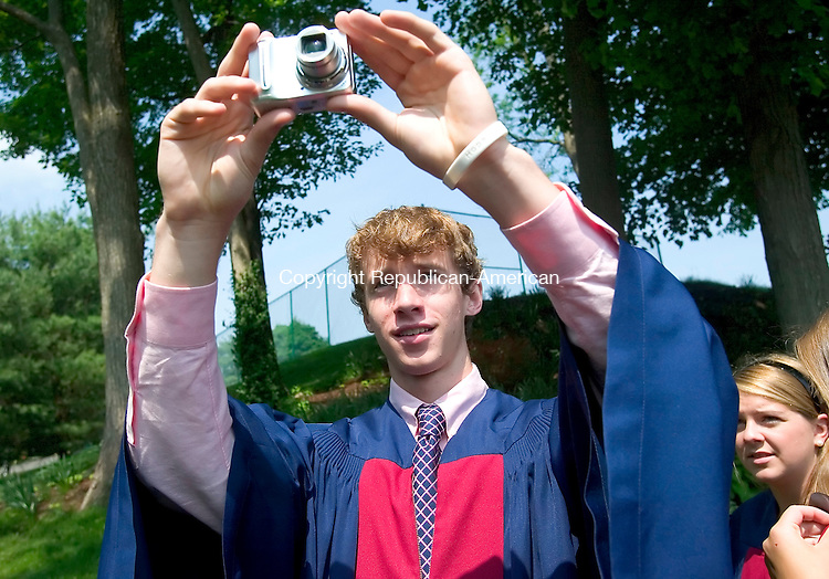 WATERTOWN, CT. 26 May 2007-052607SV01--Gordon Atkins, 17, of Somers NY. takes a photo of fellow graduates during the Taft graduation Ceremony in Watertown Saturday.<br /> Steven Valenti Republican-American