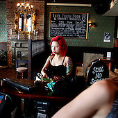 Red haired girl smoking a cigarette at a pub in Brighton, July 2010.(Photo by Piotr Malecki / Napo Images)<br />