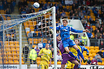 St Johnstone v Hibs...02.10.10  .Murray Davidson gets above Mark Brown but heads over.Picture by Graeme Hart..Copyright Perthshire Picture Agency.Tel: 01738 623350  Mobile: 07990 594431