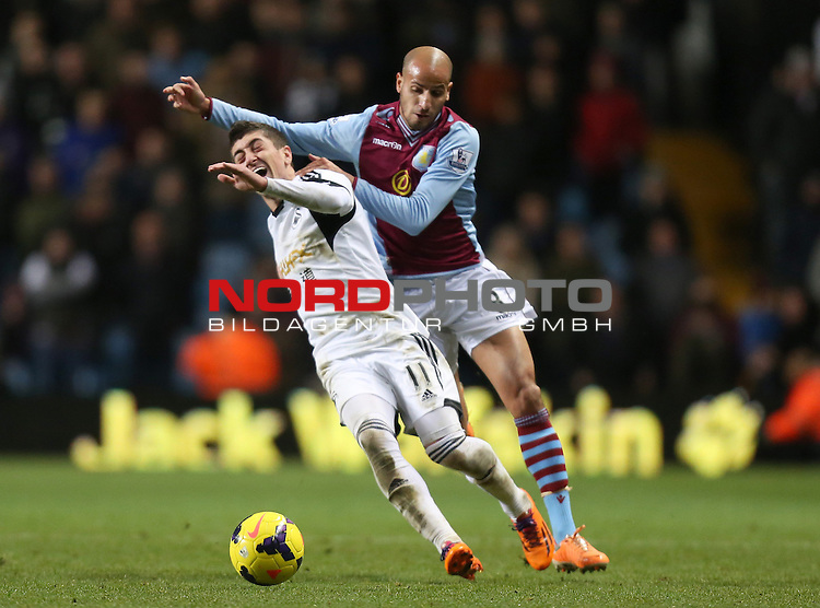 Aston Villa's Karim El Ahmadi pulls back Swansea City's Pablo Hernandez -  28/12/2013 - SPORT - FOOTBALL - Villa Park - Birmingham - Aston Villa v Swansea City - Barclays Premier League<br /> Foto nph / Meredith<br /> <br /> ***** OUT OF UK *****