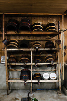 """Traditional buckets used in the brewing of sake. Tsukinokatsura sake brewery, Fushimi, Kyoto, Japan, October 10, 2015. Tsukinokatsura Sake Brewery was founded in 1675 and has been run by 14 generations of the Masuda family. Based in the famous sake brewing region of Fushimi, Kyoto, it has a claim to be the first sake brewery ever to produce """"nigori"""" cloudy sake. It also brews and sells the oldest """"koshu"""" matured sake in Japan."""