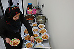A Palestinian female worker prepares the lunch meal for the elderly at El Wafa elderly nursing home, in Gaza city on Feb. 12, 2017. El Wafa elderly nursing home was established in 1980 as one of programs of Al-Wafa charity association. El-Wafa hospital was destroy during the 50-day war between Israel and Hamas militants in the summer of 2014 by Israeli forces. Photo by Sana'a Al-Ajez