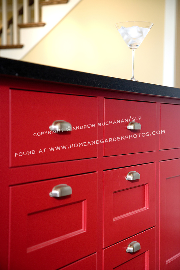 Df008909 red kitchen island stock for Brightly painted kitchen cabinets