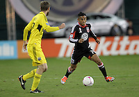 WASHINGTON, DC - OCTOBER 20, 2012:  Andy Najar (14) of D.C United approaches Eddie Gaven (12) of the Columbus Crew during an MLS match at RFK Stadium in Washington D.C. on October 20. D.C United won 3-2.