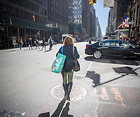 A woman with her Marshalls shopping bag in the Garment District in New York on Friday, October 14, 2016.  (© Richard B. Levine)