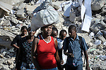 Haitians walk in the devastated center of Port-au-Prince, Haiti, which was ravaged by a January 12 earthquake.