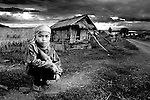 A young boy in his village in the mountains of northern laos before starting the days work on the farm in Hongsa district Sainyabuli, Laos.