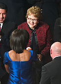 Debbie Bosanek, Assistant, Berkshire Hathaway, shakes hands with first lady Michelle Obama prior to United States President Barack Obama delivering the State of the Union Address in the U.S. House Chamber in the U.S. Capitol in Washington, D.C. on Tuesday, January 24, 2012..Credit: Ron Sachs / CNP.(RESTRICTION: NO New York or New Jersey Newspapers or newspapers within a 75 mile radius of New York City)