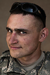 SPC Nathan El-Obari. Hurst, Texas. 20. Charlie Co. 1st Battalion 12th Infantry Regiment, 4th Infantry Division. Photographed at Combat Outpost JFM in Zhari District, Kandahar, Afghanistan.