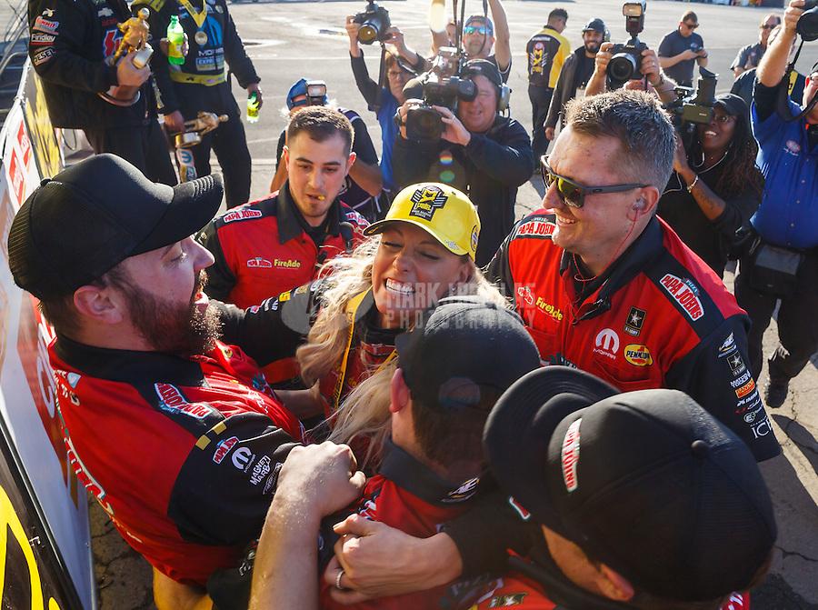Feb 12, 2017; Pomona, CA, USA; NHRA top fuel driver Leah Pritchett celebrates with her crew after winning the Winternationals at Auto Club Raceway at Pomona. Mandatory Credit: Mark J. Rebilas-USA TODAY Sports