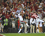 Alabama defensive back Dre Kirkpatrick (21) breaks up a pass to Ole Miss wide receiver Markeith Summers (16) at Bryant-Denny Stadium in Tuscaloosa, Ala.  on Saturday, October 16, 2010. Alabama won 23-10.