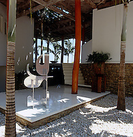 "A sculpture signed ""H. Scrive"" stands on the polished resin floor of the entrance courtyard"