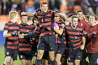 Houston, TX -  Friday, December 9, 2016: Thomas Hilliard-Arce (4) of the Stanford Cardinal celebrates with his teammates after defeating the North Carolina Tar Heels in an overtime shootout at the  NCAA Men's Soccer Semifinals at BBVA Compass Stadium.
