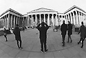 London, UK. 16.01.2016. Tourists take photos outside the main entrance to the British Museum. Photograph © Jane Hobson.