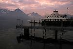 Car ferry on the lake at dawn, Stätter See. Beckenried to Gersau ferry. Beckenried, Luzern area, Switzerland.