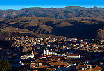 Sunrise illuminates the monastery of San Felipe de Neri and its red roofed domes in the colonial city of Sucre, Bolivia.  At an altitude of 9,000 feet above sea level, Sucre sits in a valley surrounded by low mountains and is nicknamed the 'White City' because of its whitewashed colonial architecture.  The city was declared a UNESCO World Heritage Site in 1991.