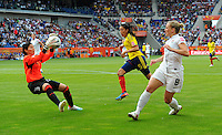 Amy Rodriguez (r) of team USA and Sandra Sepulveda (l) of team Colombia during the FIFA Women's World Cup at the FIFA Stadium in Sinsheim, Germany on July 2nd, 2011.