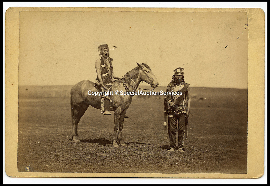 BNPS.co.uk (01202 558833)<br /> Pic: SpecialAuctionServices/BNPS<br /> <br /> *Please use full byline*<br /> <br /> Lot 406-8. Big John &amp; Brother, Cree Scouts.<br /> <br /> Poignant insight into a lost world...<br /> <br /> An important collection of Native American Images - including a portrait of the famous Sitting Bull - will be offered in the Photographica sale on Thursday 23rd October and is expected to fetch over &pound;10,000.<br /> <br /> The photographs were collected by the vendor&rsquo;s great grandfather during his travels to America. He first journeyed to North America in 1862 to find out more about Native Indians and subsequently returned in 1866, 1874 and several times after that. The first three trips are described in a book that he wrote and published in 1890 entitled Sport and Adventures amongst the North American Indians.<br /> <br /> The collection comprises 127 images taken by pioneering photographers including American government photographer John Karl Hillers (1843- 1925) and explorer and painter William. H. Jackson. It contains portraits as well as scenes of family and working life that provide a real insight into everyday living in the 1870s &ndash; 1880s. Estimates for the group lots range from &pound;100 to &pound;5,000.<br /> <br /> The photographs were taken using the latest technology of the time; the invention of dry-plate made it possible for photographers to go into the wilds of native USA and document everyday life; and the use of traditional stereoscopic photography means the subjects in the portrait shots appear 3-Dimensional. <br /> <br /> Hugo Marsh, Head of Photographica says: &ldquo;This collection of photographs provides us with a greater understanding and a terrific insight into the lives of Native American Indians of the time. It is rare to see a large collection in such good condition.&rdquo;