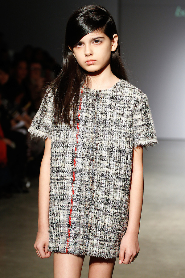 Young model walks runway in an outfit from the Bonnie Young Fall 2014 collection, at petitePARADE Fall 2014, during Kids Fashion Week in New York City, on March 8, 2014.
