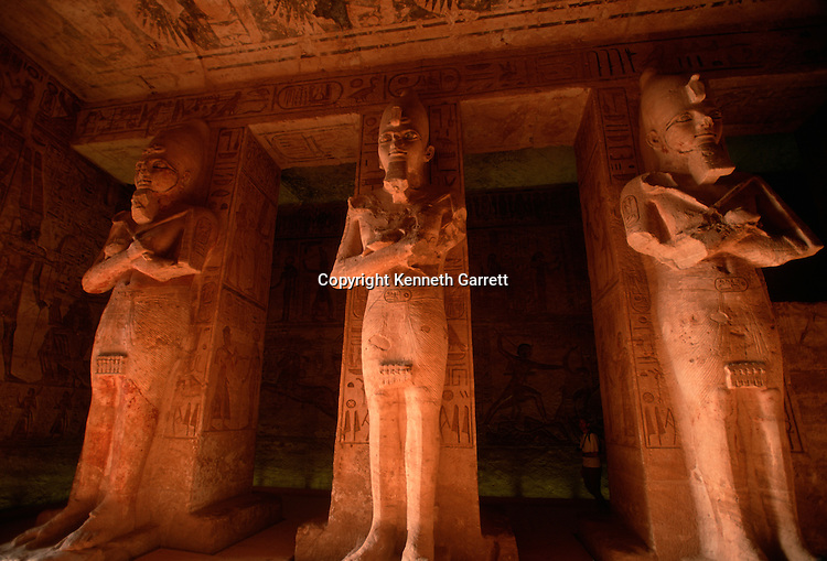 Detail of pillared hall in Great Temple, Abu Simbel, Egypt, Colossal figures of Ramses II as Osiris, Battle of Kadesh relief on wall, New Kingdom.