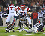 Louisiana-Lafayette's Brad McGuire (8)  is tackled by Ole Miss safety Johnny Brown (20) in Oxford, Miss. on Saturday, November 6, 2010. Ole Miss won 43-21.
