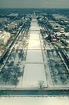Looking east from the top of the Washington Monument, snow covers the National Mall leading to the Capitol.