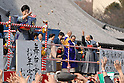 Actress Tamao Nakamura throws roasted soy beans and snacks toward people at Tokyo's Zojoji temple as part of the Setsubun festival which marks the lunar calendar start of spring. The beans are supposed to drive away the evil spirits that bring misfortune and bad health with them.