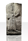 Picture & image of a Neo-Hittite orthostat showing a releif sculpture  of the Goddess Kubaba from Karkamis,, Turkey. Ancora Archaeological Museum. 5 In her right hand she is holding a pomegranate