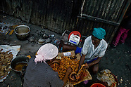 Women process pork intestines after the pig was slaughtered in front of a shack close to the La Saline market, in Port-au-Prince, Haiti, 12 July 2008. The sources of food on Haiti are very limited. The overall situation on Haiti gets worse every year and the extreme, hardly imaginable poverty hits more and more people. The Haitian economics is paralysed, there is no infrastructure, no food supplies, the population suffer from hunger, social and living conditions in Haitian slums (e.g. Cité Soleil) are a human tragedy. The rage grows and the tension continues with undiminished strength.
