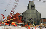 WATERBURY, CT 02 January 2008-010209SV08--A new power plant superstructure towers over the old Ansonia Copper &amp; Brass building on Bank Street in Waterbury Friday.  First Light Power Resources&rsquo; Waterbury Generation Project consists of an approximately 96-megawatt generator being built on the Brownfield site on Washington Avenue. This generator is a state-of-the-art combustion turbine manufactured by the General Electric Company that will, during periods of high electric loads, primarily burn natural gas.<br /> Steven Valenti Republican-American