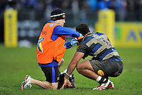 Amanaki Mafi of Bath Rugby is treated for an injury by Physiotherapist Cerian Parham. Aviva Premiership match, between Bath Rugby and Wasps on February 20, 2016 at the Recreation Ground in Bath, England. Photo by: Patrick Khachfe / Onside Images