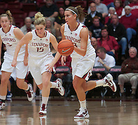 STANFORD, CA:  Jeanette Pohlen drives with Mikaela Ruef (3) and Lindy La Rocque (15) during Stanford's 77-40 victory over Fresno State at Stanford, California on December 12, 2010.