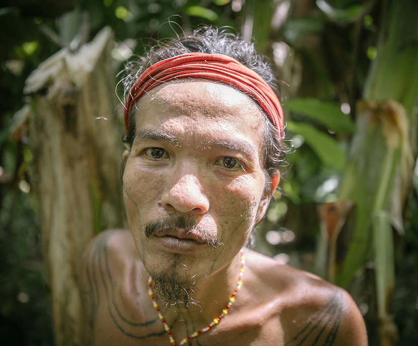 Rua Manai, a Mentawai shaman. The Mentawai are the tribes living traditionally in the island of Siberut, Indonesia. Here, where the changes came slow, some of the people are still living like their ancestors did centuries ago. They s till practice ancient religion called Arat Sabulungan, which believe that everything in the forest has a spirit.