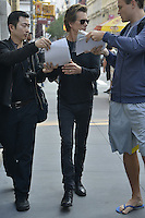 JUL 29 Kevin Bacon seen signing autographs in SoHo