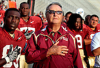 TALLAHASSEE, FL. 4/4/09-BOWDEN CH2-Coach Bobby Bowden, center, joins Louis Givens, left and others as they sing the National Anthem Saturday before the Garnet and Gold game at Doak Campbell Stadium in Tallahassee...COLIN HACKLEY PHOTO FOR THE OSCEOLA