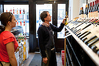 An employee advises a customer at Chambers Street Wines in New York, NY, USA, 22 May 2009. The store specializes in naturally made wines from artisanal small producers and has received a Slow Food NYC Snail of Approval.