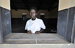 A student in the Southern Sudanese village of Jombo poses in the window of a classroom in a new village school constructed by the United Methodist Committee on Relief (UMCOR). Families here are rebuilding their lives after returning from refuge in Uganda.