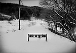 Nuclear winter in Fukushima, Prefecture: Barrier barring entry into Iitate-mura village buried in snow.  Iitate-mura is in the heart of the expanded nuclear evacuation zone because of high wind-friven radioactive fall-out from explosions at the Fukushima Dai Ichi nuclear power plant and residents are not likely to return for years or maybe for decades.  Iitate-mura was contaminated by wind-driven radioactive fall-out from the Fukushima Dai Ichi nuclear power plant.  Iitate-mura sits in an area that annual ambient radiation rates are estimated to be over 20 millisieverts in most areas and others are at over 50 millisieverts annually, the latter of which may indicate that decontamination may take decades.