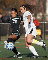 College of St Rose forward Carmelina Puopolo (5) dribbles as Wilmington University defender Sarah Lindler (26) defends.. In 2012 NCAA Division II Women's Soccer Championship Tournament First Round, College of St Rose (white) defeated Wilmington University (black), 3-0, on Ronald J. Abdow Field at American International College on November 9, 2012.