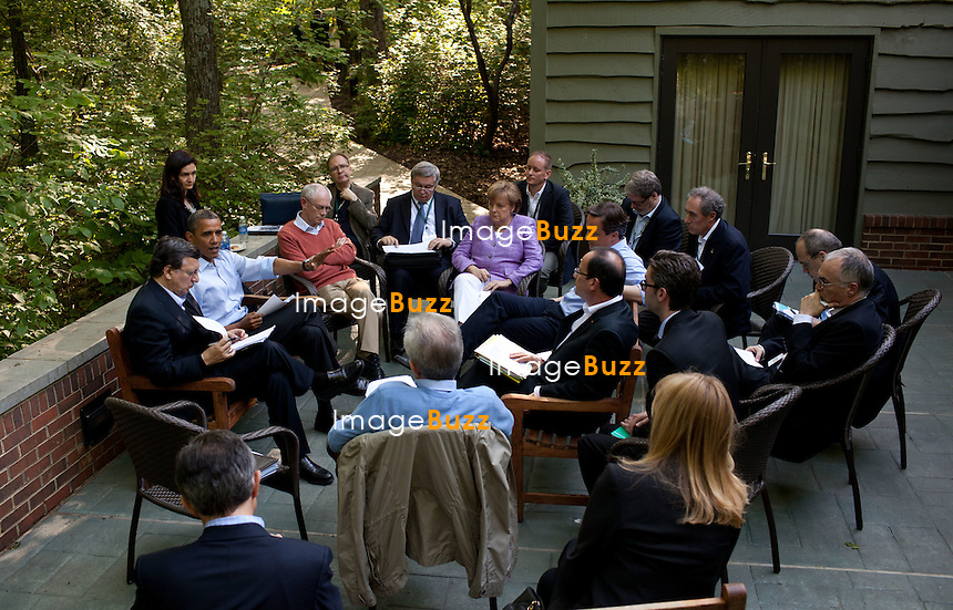 President Barack Obama meets with Eurozone leaders on the Laurel Cabin patio during the G8 Summit at Camp David, Maryland, May 19, 2012.