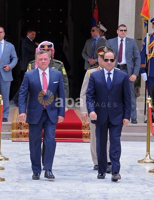 Egyptian President Abdel Fattah al-Sisi and Jordan's King Abdullah II review the honour guard during a welcome ceremony in the Egyptian capital Cairo, on May 17, 2017. Photo by Egyptian President Office