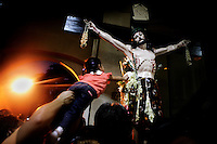 Catholics touch the crucifix as part of a religious ceremony at the Baclaran Church. The Catholic Church is the most dominant religion in the country and a vocal opponent against abortion, sterilization and all other forms of contraception.The church has considerable influence on government policy and has succeeded in a reduction of government campaigns on pregnancy-prevention and sexual education.
