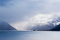 Storm over sea and snow covered mountains, Norway