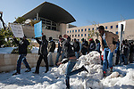 African immigrant protestors march towards the Israeli parliament (not seen), in Jerusalem, Israel. Some 200 African asylum-seekers, who illegally entered Israel, demonstrated against their condition at a detention facility, from which they walked out of two days earlier. Israeli police and immigration arrested all protestors, and sent them back to Saharonim detention facility in the Negev desert.